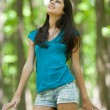 Stock Photo: Attractive hispanic girl in forest