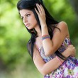 Beautiful brunette young lady outdoor — Stock fotografie