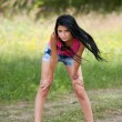 Attractive latin girl posing outdoor - Stok fotoraf