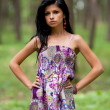 Attractive hispanic girl in the forest - Stok fotoraf