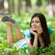 Attractive lady in the forest — Stockfoto