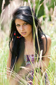Beautiful brunette young lady outdoor — Stok fotoğraf
