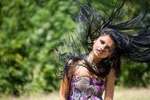 Brunette flipping her hair — Stock Photo