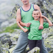 Foto Stock: Father and son in mountains