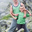 Stockfoto: Father and son in mountains