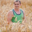 Young farmer in his wheat field — Stock Photo