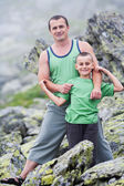 Father and son in mountains — Stok fotoğraf