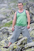 Young man in mountains — Stock Photo
