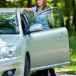Woman with car — Stock Photo #3548805