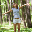 Happy woman in forest — Stockfoto
