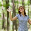 Happy woman in forest — Stok fotoğraf
