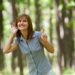 Woman in the forest - Stock Photo