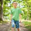 Cute boy walking through the forest — Stockfoto #3574436