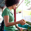 Woman buying vegetables - Stock Photo