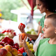 Cute boy at the farmer's market — Stock Photo