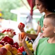 Cute boy at the farmer's market — Stock Photo #3574486