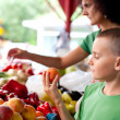 Cute boy buying vegetables — Stockfoto #3574493