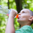 Cute child drinking water — Stock Photo