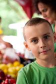 Cute boy at the farmer's market — Stock Photo