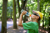 Cute child drinking water — Foto Stock