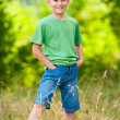 Young boy in a forest — Stock Photo