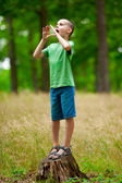 Beautiful child outdoor having fun — Stock Photo