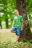 Little boy in the forest — Stock Photo