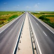 Highway under blue sky - Stock Photo