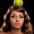 Woman with apple on head — Stock Photo