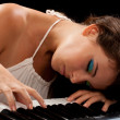 Young lady at the piano - Stock Photo