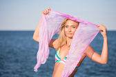 Beautiful young woman with veil at sea — Stock Photo
