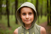 Kid with hood outdoors — Stock Photo