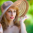 Beautiful blonde with hat outdoors — Stock Photo #3649946