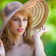 Stock Photo: Beautiful blonde with hat outdoors