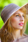 Beautiful blonde with hat outdoors — Stock Photo