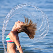 Beautiful young lady splashing with her hair — Stock Photo