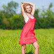 Young lady in red dress — Stock Photo