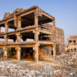 Stock Photo: After natural disaster - ruined buildings