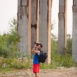Photographer taking pictures of ruins - Stock Photo