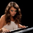 Young lady playing piano — Stock Photo #3653028