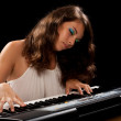 Young lady playing piano — Stock Photo