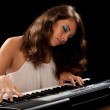 Young lady playing piano — Stock Photo #3653032