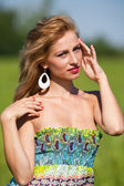 Young lady with colorful dress — Stock Photo
