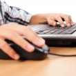 Kid using mouse and keyboard — Stock Photo