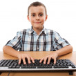 Cute kid at the keyboard — 图库照片