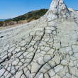 Cracked ground from muddy volcanoes in Romania - Stok fotoraf