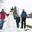 Three boys and the snowman — Stock Photo