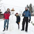 Three boys and the snowman — Stock Photo #3735853