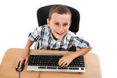 Kid using keyboard and mouse — Stock Photo