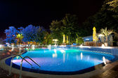 Hotel pool at night — Stock Photo